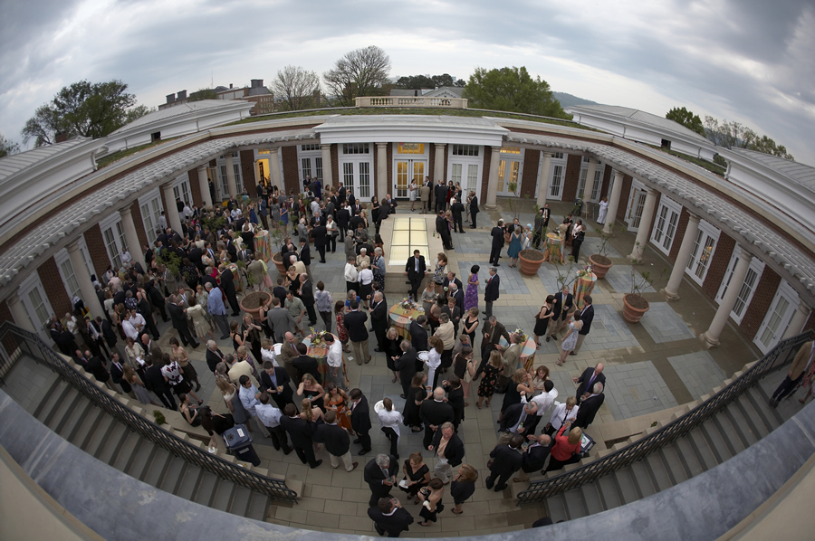 People gather in the courtyard of Rouss & Robertson Halls to celebrate the dedication.